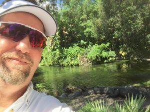 irs tax help attorney with alligator behind him